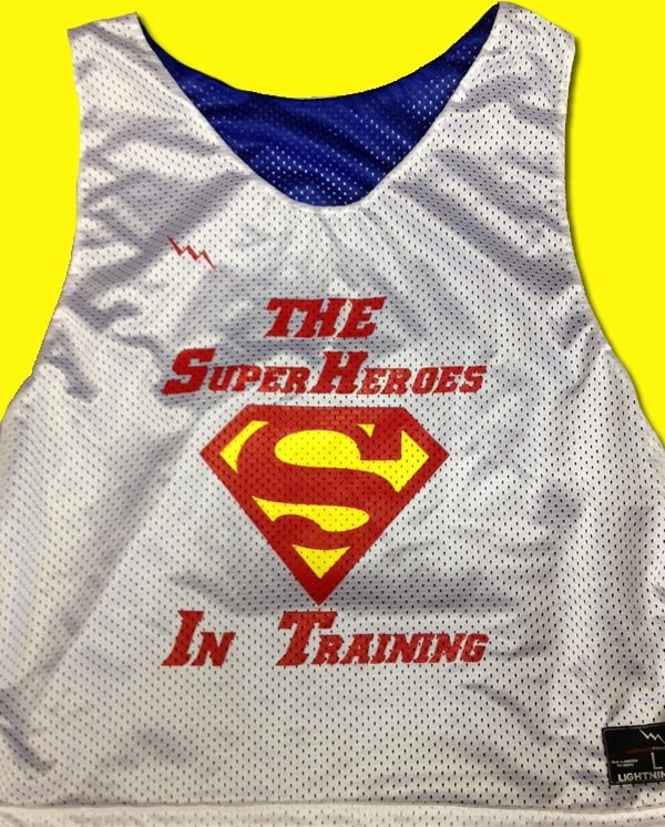 the super heros in training pinnies