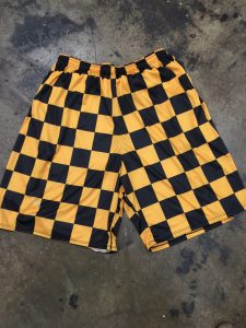 black gold checker board shorts
