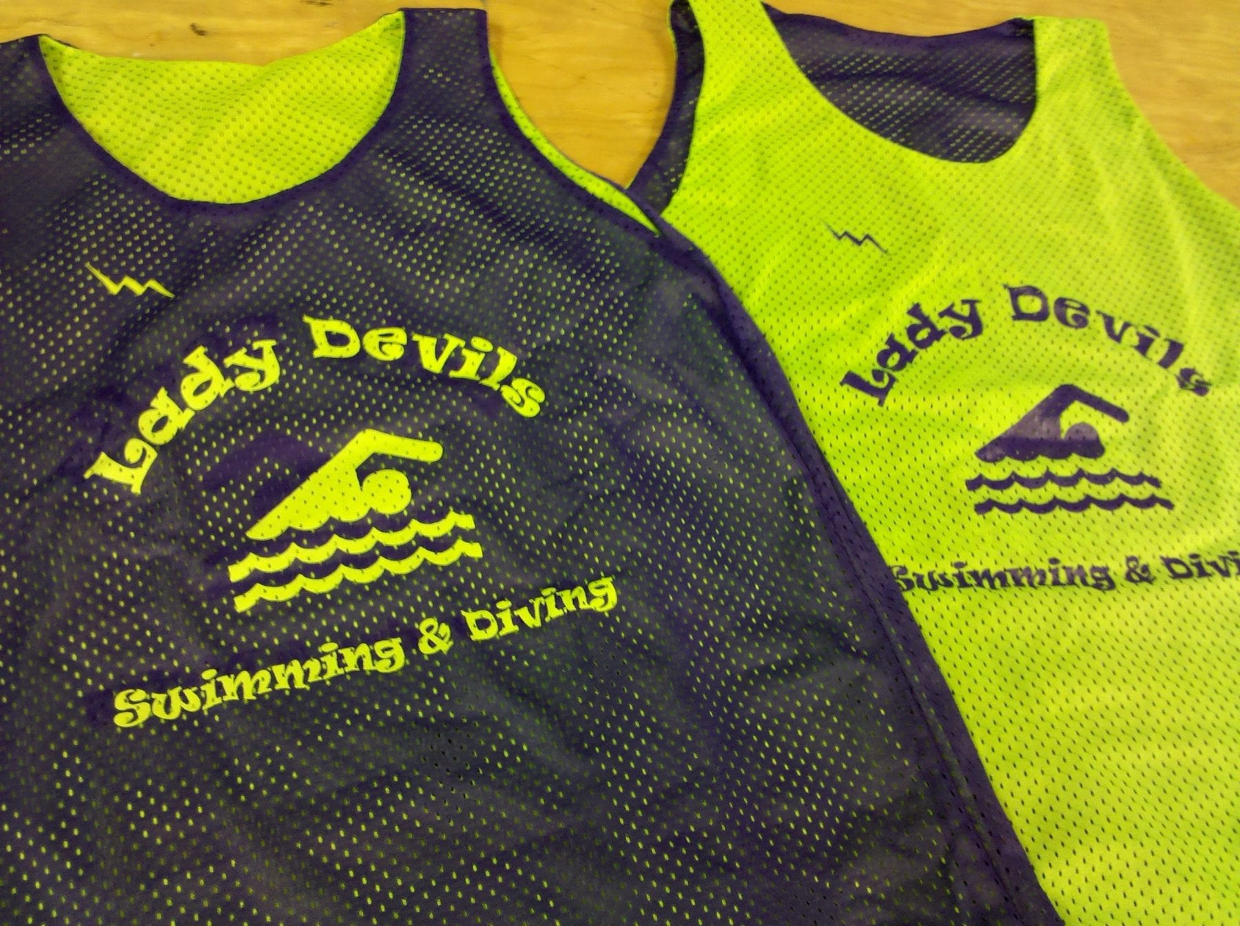 lady devils swimming pinnies